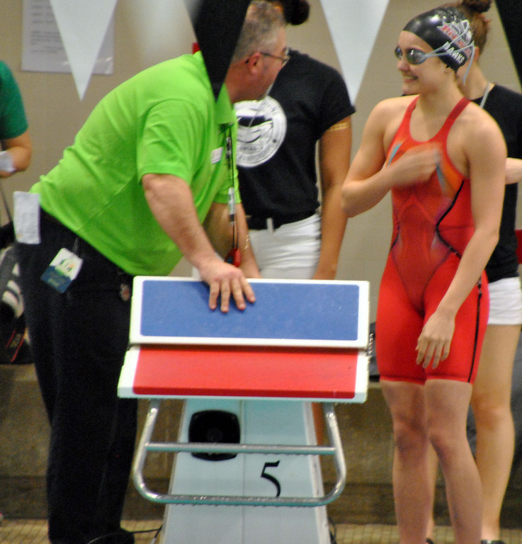 . Jon Behm - The Morning Journal Rocky River senior Laura Banks takes a moment to talk with an official prior to her 100 breaststroke swim at the D-I State meet on Feb. 25.