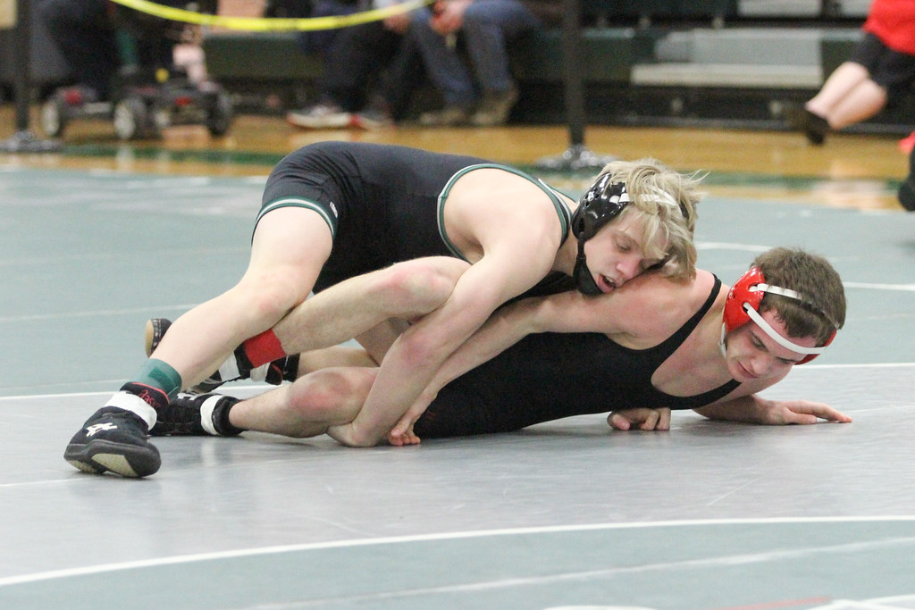 . Barry Booher - The News-Herald Conor McCrone ( Lake Catholic ) (TOP) v David Boykin ( Harvey ) 113 LBS.