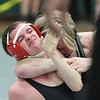 Barry Booher - The News-Herald<br /> Conor McCrone ( Lake Catholic ) puts David Boykin ( Harvey ) in a head lock. 113LBS.