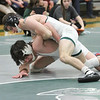 Barry Booher - The News-Herald<br /> Hunter Ryan ( Lake Catholic ) locks up Adam Williams ( West Geauga ) 120 LBS.