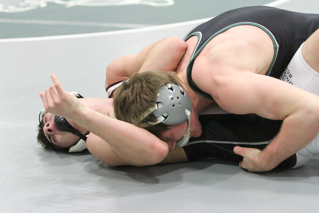 . Barry Booher - The News-Herald Luke McKeon ( Lake Catholic ) pins Paul Averill ( University ) 138 LBS.