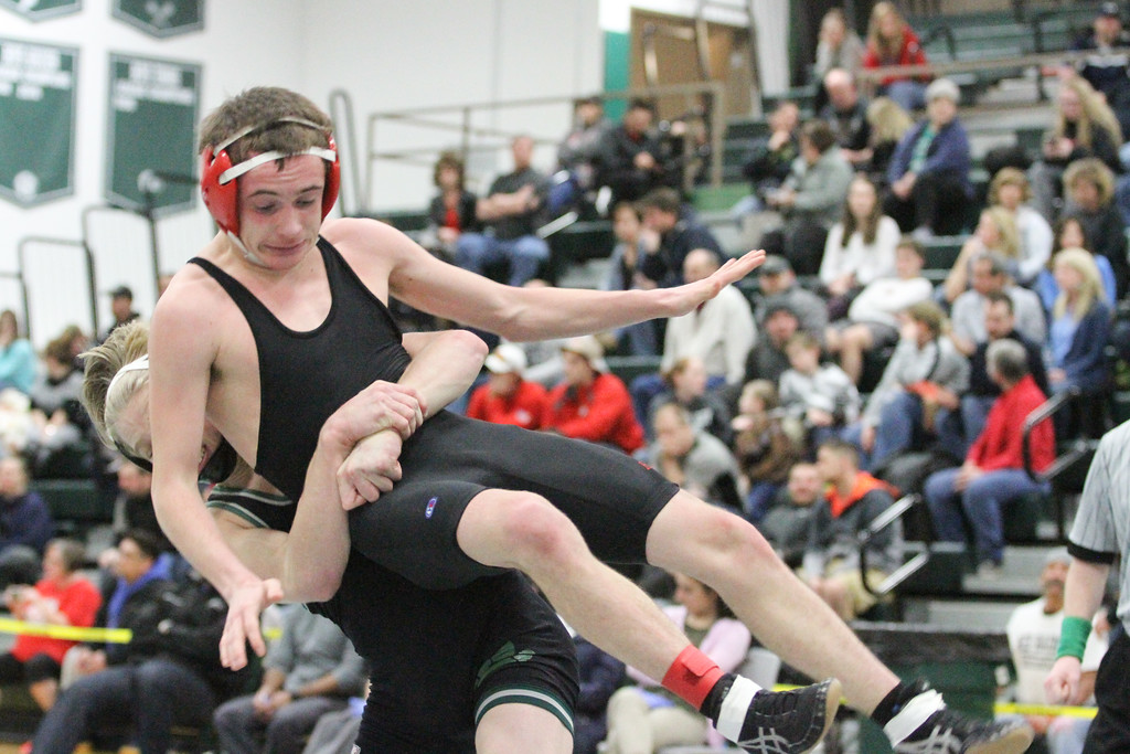 . Barry Booher - The News-Herald Conor McCrone ( Lake Catholic ) body slams David Boykin ( Harvey ) 113 LBS.