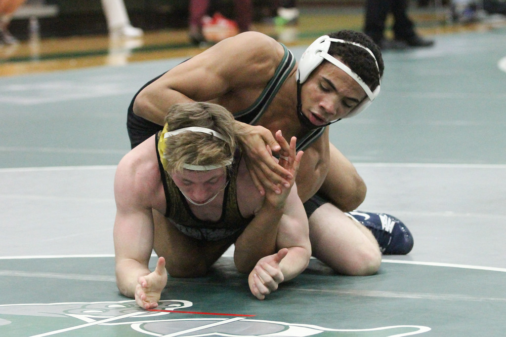 . Barry Booher - The News-Herald Kevon Freeman ( Lake Catholic ) (TOP) v Justin Mason ( Conneaut ) 145 LBS.