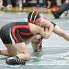 Barry Booher - The News-Herald<br /> Kyle Rowan ( Perry ) wraps up Jason Mayes ( Jefferson ) 106LBS.