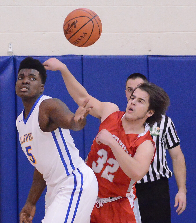 . Eric Bonzar �The Morning Journal Clearview\'s DeAri Todd and Fairview\'s Arjol Arapi battle for a loose ball rebound, Feb. 26.