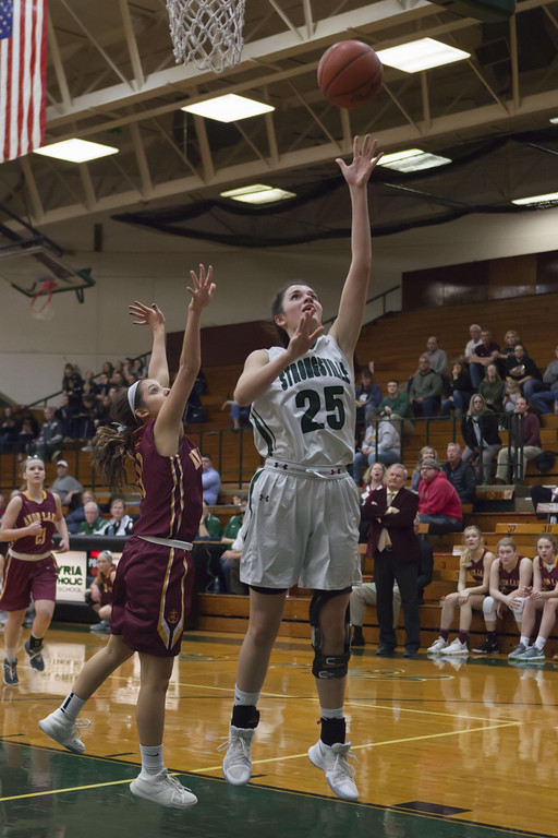 . Jen Forbus - The Morning Journal Mustang Lindsey Thall lays a shot up to the basket in Monday night\'s district semifinal game against Avon Lake.