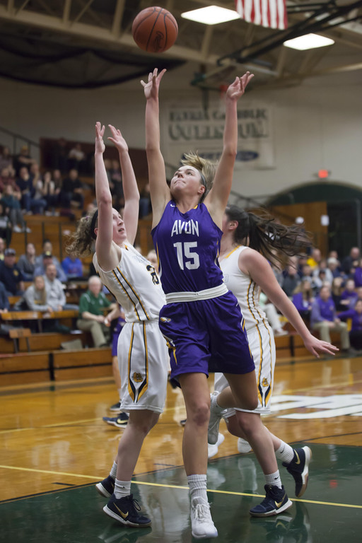 . Jen Forbus - The Morning Journal Driving through the Olmsted Falls defense, Avon\'s Maggie Beatty tosses a shot up toward the basket.
