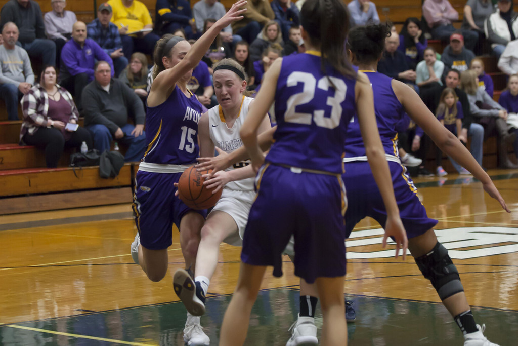 . Jen Forbus - The Morning Journal Bulldog Sarah Balfour tries to drive her way through several Avon defenders in Monday night\'s district semifinal game.