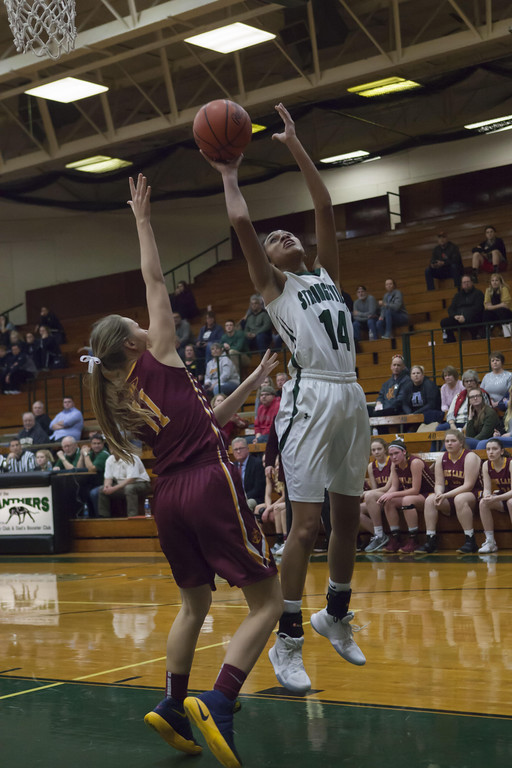 . Jen Forbus - The Morning Journal Strongsville\'s Marnae Holland takes to the air to shoot against Avon Lake\'s Taylor Baiers.