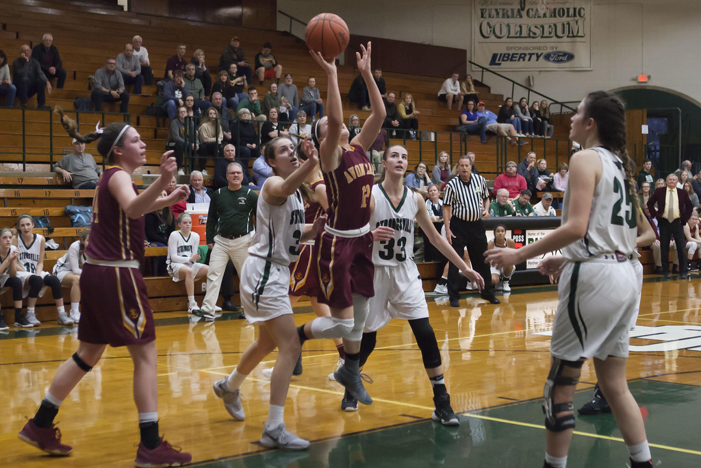 . Jen Forbus - The Morning Journal Shoregal Ariana Negron soars toward the basket, despite being surrounded by Mustang defense.