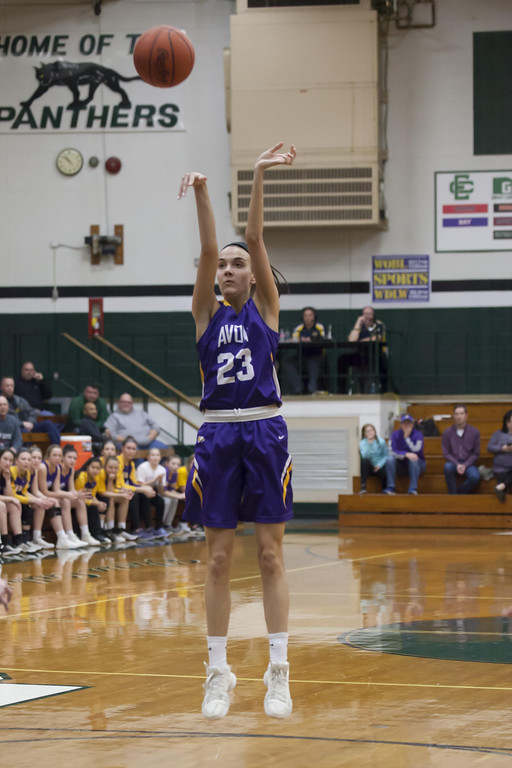 . Jen Forbus - The Morning Journal From the top of the key, Eagle Elizabeth Flynn tries for two in Monday\'s district semifinal game against the Olmsted Falls Bulldogs.