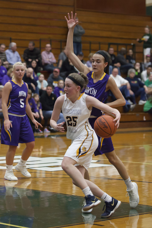 . Jen Forbus - The Morning Journal Olmsted Falls\' Sarah Balfour drives the lane past Avon\'s Elizabeth Flynn.