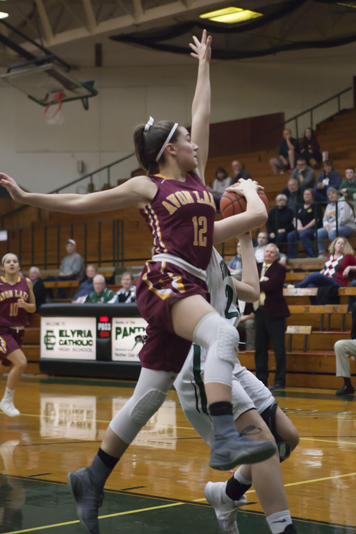 . Jen Forbus - The Morning Journal  Ariana Negron of Avon Lake leaps to block a shot.