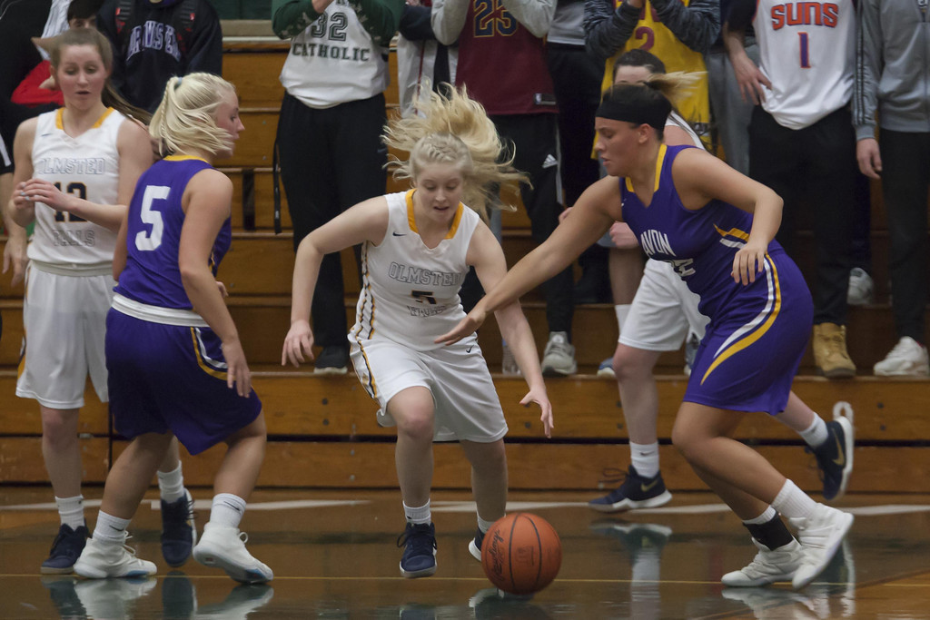 . Jen Forbus - The Morning Journal  Avon\'s Juliann Walker and Olmsted Falls\' Kaitlyn Hradek dive for the loose basketball in Monday\'s district semifinal game at Elyria Catholic High School.