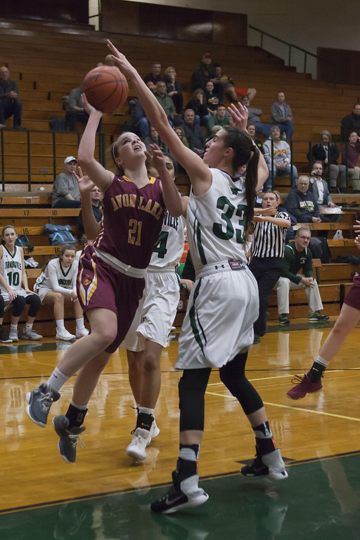 . Jen Forbus - The Morning Journal Mustang Reagan Bass gets a hand on the ball to block Shoregal Elizabeth Murdock\'s shot.