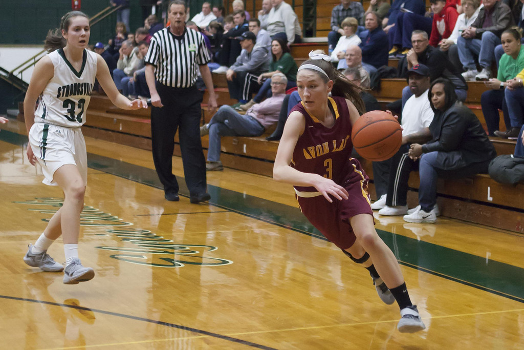. Jen Forbus - The Morning Journal Avon Lake\'s Anna Robinson drives toward the Shoregal basket in Monday night\'s district semifinal game with the Strongsville Mustangs.