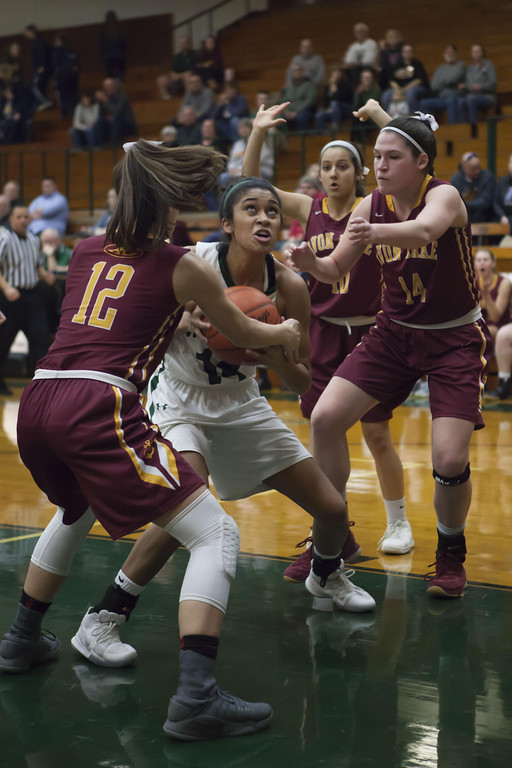 . Jen Forbus - The Morning Journal Strongsville\'s Marnae Holland keeps her eye on the basket despite being surrounded by Avon Lake defenders.