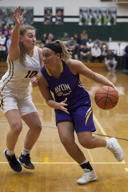 . Jen Forbus - The Morning Journal Bulldog Danielle Stevens puts herself between Avon\'s Juliann Walker and the basket during Monday night\'s district semifinal game.