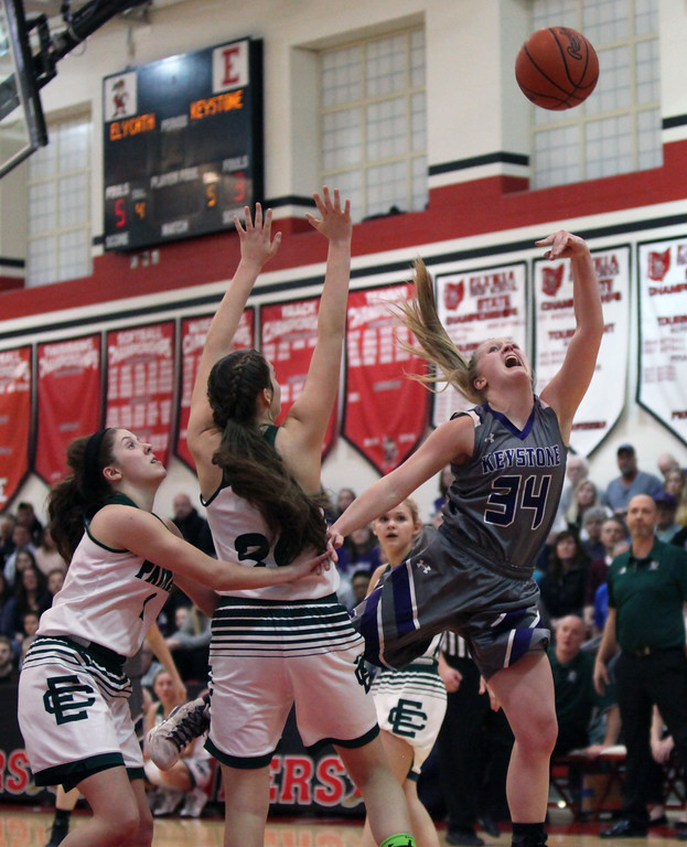 . Randy Meyers - The Morning Journal Keystone\'s McKenah Peters puts up an off-balance shot against Megan Scheibelhut of Elyria Catholic during the second quarter of a D-II Elyria District semifinal on Feb. 27.