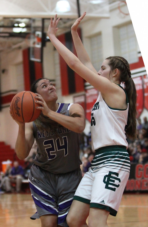. Randy Meyers - The Morning Journal Keystone\'s Sammie Stefan looks to shoot over Elyria Catholic\'s Megan Scheibelhut during the second quarter at a D-II Elyria District semifinal on Feb. 27.