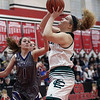 Randy Meyers - The Morning Journal<br /> Abby Winnen of Elyria Catholic grabs a rebound and puts up a shot over Jena Copley of Keystone during a D-II Elyria District semifinal on Feb. 27.