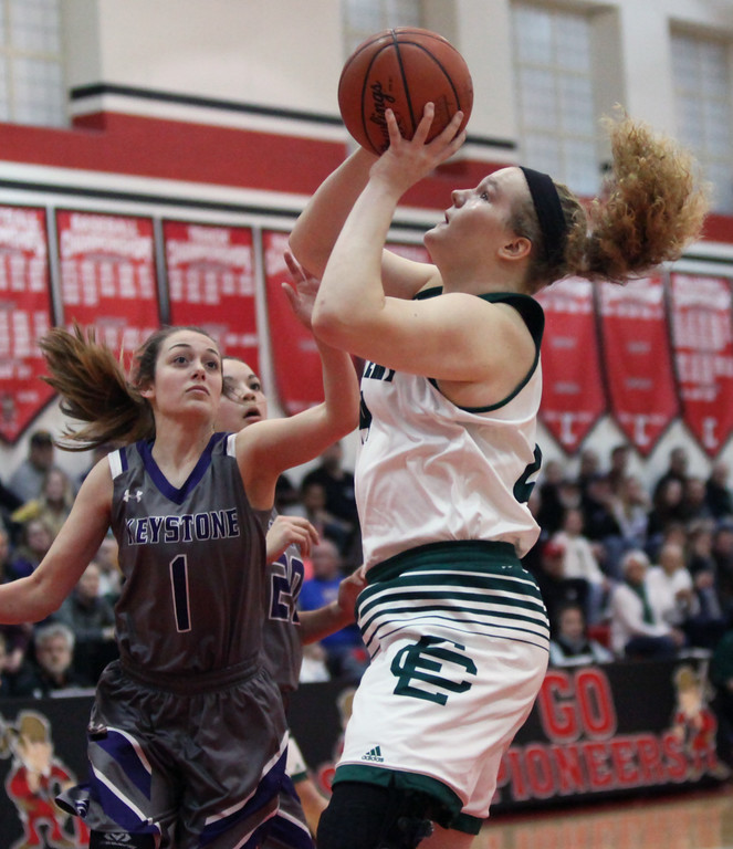 . Randy Meyers - The Morning Journal Abby Winnen of Elyria Catholic grabs a rebound and puts up a shot over Jena Copley of Keystone during a D-II Elyria District semifinal on Feb. 27.