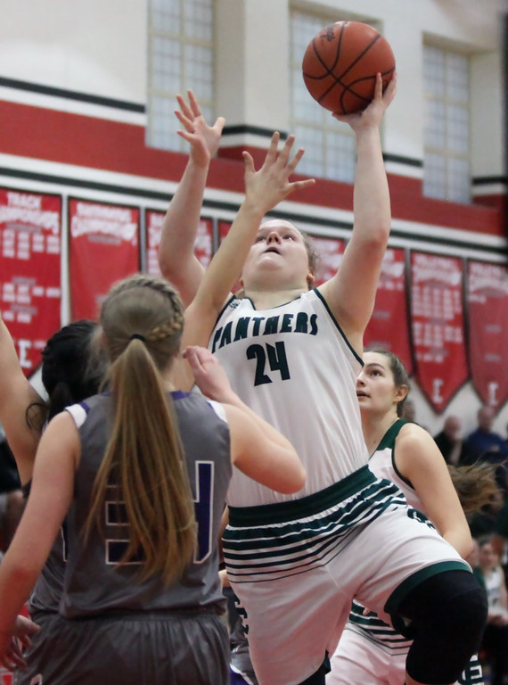 . Randy Meyers - The Morning Journal Elyria Catholic\'s Abby Winnen shoots over Taylor Stefan of Keystone during the first quarter of a D-II Elyria District semifinal on Feb. 27.