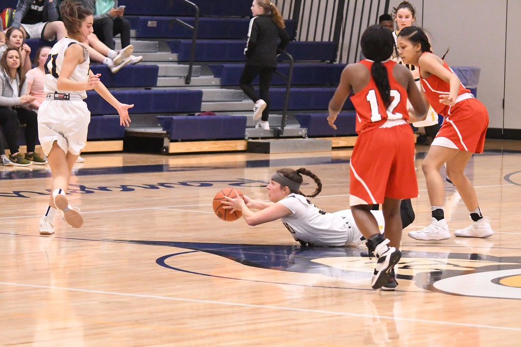 . Eric Bonzar�The Morning Journal<br> Kirtland\'s Amber Yurick tosses the ball to teammate Julia Camino (11) while on the ground.
