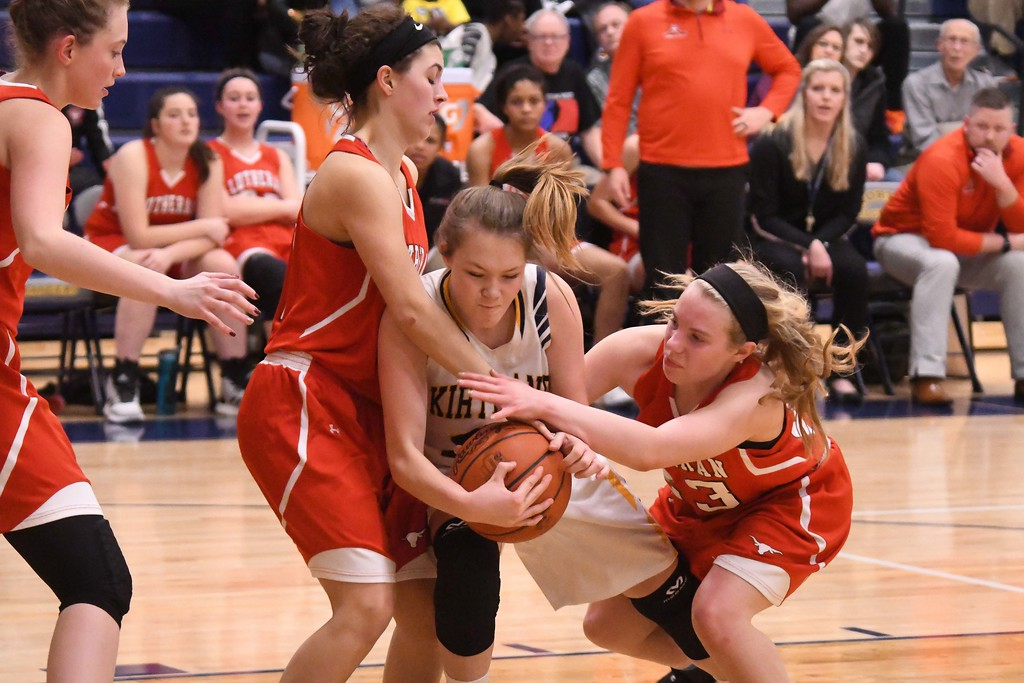 . Eric Bonzar�The Morning Journal<br> Kirtland\'s Lauren Lutz fights for a loose ball from Lutheran West\'s Paris Mather (23) and Alyssa Scolaro.