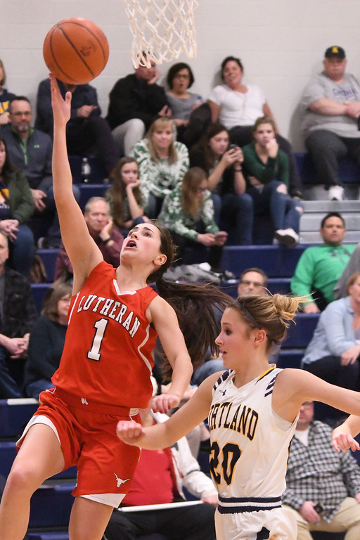 . Eric Bonzar�The Morning Journal<br> Lutheran West\'s Abriana Rondin (1) gets past Kirtland\'s Sydney Snyder (20) for a layup.