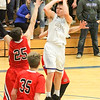 Barry Booher - The News-Herald<br /> Zach Guyer pulls up for a jumpshot over the defense of Chardon's Joe Scerbo. Guyer scored 18 points in Madison's 69-55 win.