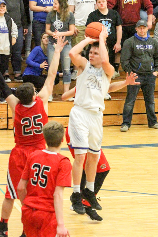 . Barry Booher - The News-Herald Zach Guyer pulls up for a jumpshot over the defense of Chardon\'s Joe Scerbo. Guyer scored 18 points in Madison\'s 69-55 win.