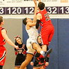 Barry Booher - The News-Herald<br /> Chardon's Joe Scerbo contests the shot of Madison's Dhel Duncan-Busby. Madison won, 69-55.