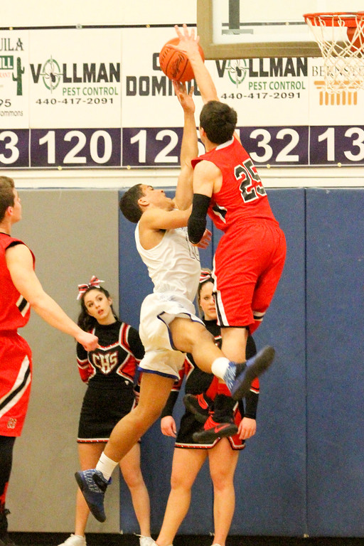 . Barry Booher - The News-Herald Chardon\'s Joe Scerbo contests the shot of Madison\'s Dhel Duncan-Busby. Madison won, 69-55.