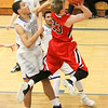 Barry Booher - The News-Herald<br /> Chardon's Alex Sulka attempts a layup past Madison's Dhel Duncan-Busby. Madison won, 69-55.