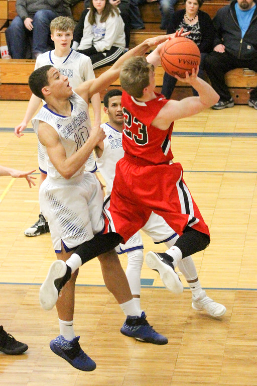 . Barry Booher - The News-Herald Chardon\'s Alex Sulka attempts a layup past Madison\'s Dhel Duncan-Busby. Madison won, 69-55.