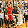 Barry Booher - The News-Herald<br /> Chardon's Mike Laudato pulls up for a corner 3-pointer over Madison's Zach Guyer. Madison won, 69-55.