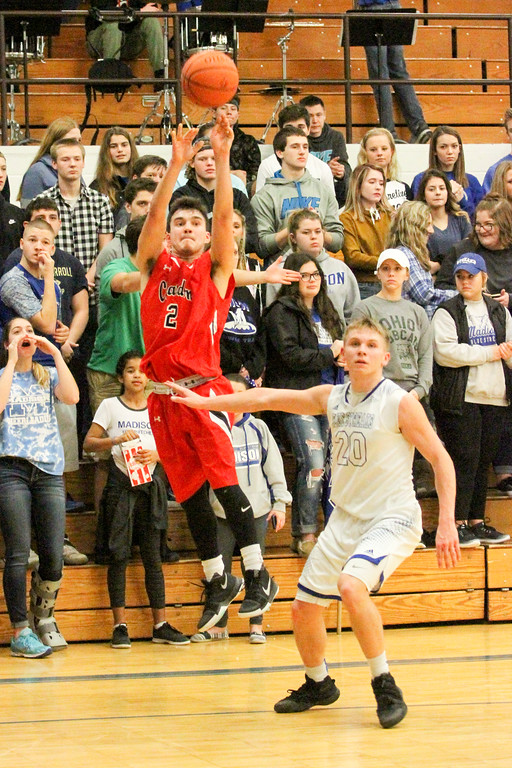 . Barry Booher - The News-Herald Chardon\'s Mike Laudato pulls up for a corner 3-pointer over Madison\'s Zach Guyer. Madison won, 69-55.