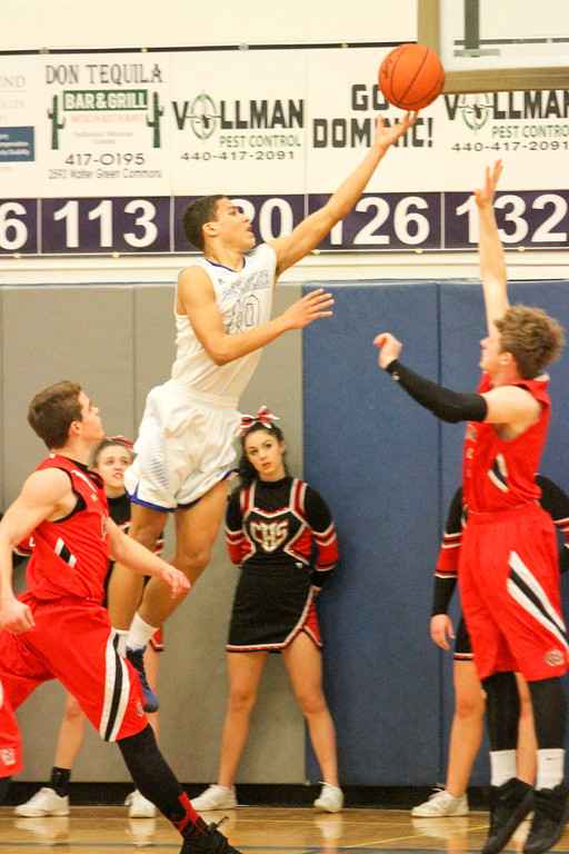 . Barry Booher - The News-Herald Madison\'s Dhel Duncan-Busby lays the ball in past the defense of Chardon\'s Shane Quin (left) and Jake Niehus (right). Duncan-Busby scored 28 points in Madison\'s 69-55 win.