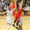 Barry Booher - The News-Herald<br /> Chardon's Alex Sulka lays the ball in past Madison's Corbin Anthony. Madison won, 69-55.