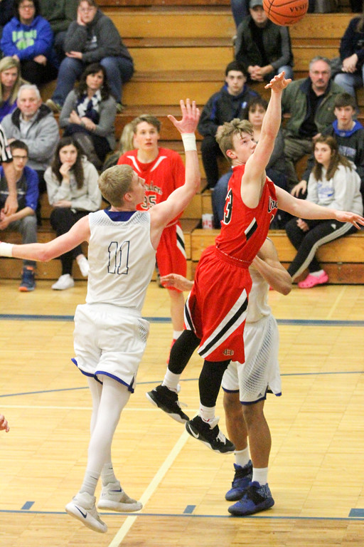 . Barry Booher - The News-Herald Chardon\'s Alex Sulka lays the ball in past Madison\'s Corbin Anthony. Madison won, 69-55.