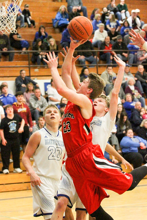 . Barry Booher - The News-Herald Chardon\'s Alex Sulka attempts a layup past the defense of Madison\'s Marcus Horton and Zach Guyer (20). Madison won, 69-55.