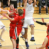Barry Booher - The News-Herald<br /> Madison's Dhel Duncan-Busby drives into a host of Chardon defenders. Duncan-Busby scored 28 points in Madison's 69-55 win.