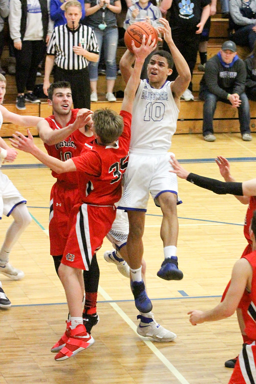 . Barry Booher - The News-Herald Madison\'s Dhel Duncan-Busby drives into a host of Chardon defenders. Duncan-Busby scored 28 points in Madison\'s 69-55 win.
