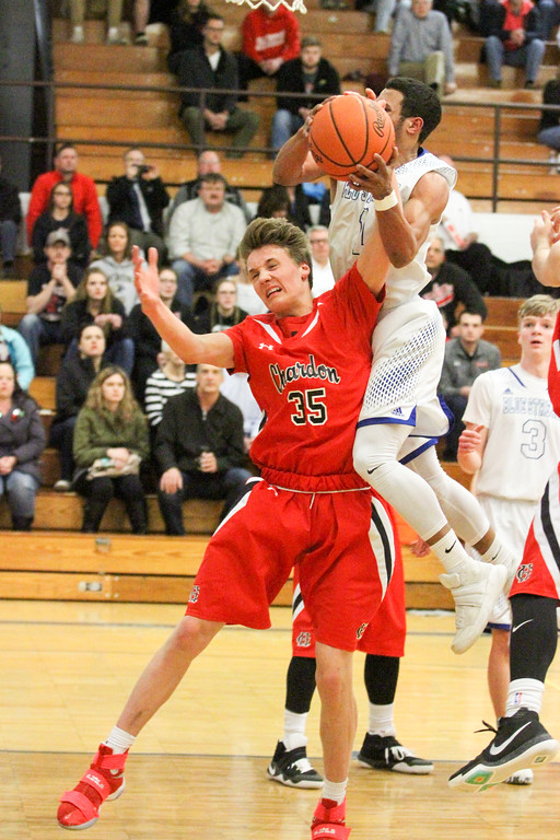 . Barry Booher - The News-Herald Madison\'s Isaiah McClure drives to the basket against Chardon\'s Ben Sulka. Madison won, 69-55.