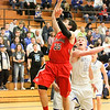 Barry Booher - The News-Herald<br /> Chardon's Joe Scerbo lays the ball in past Madison's Corbin Anthony. Madison won, 69-55.