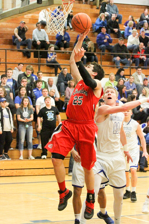. Barry Booher - The News-Herald Chardon\'s Joe Scerbo lays the ball in past Madison\'s Corbin Anthony. Madison won, 69-55.