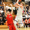 Barry Booher - The News-Herald<br /> Madison's Corbin Anthony shoots over Chardon's Mike Laudato. Madison won, 69-55.