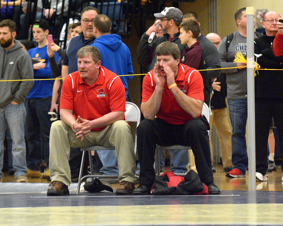 . Steve Hare - The News-Herald Cardinal coaches, at the Division III Garfield Heights District on March 2.