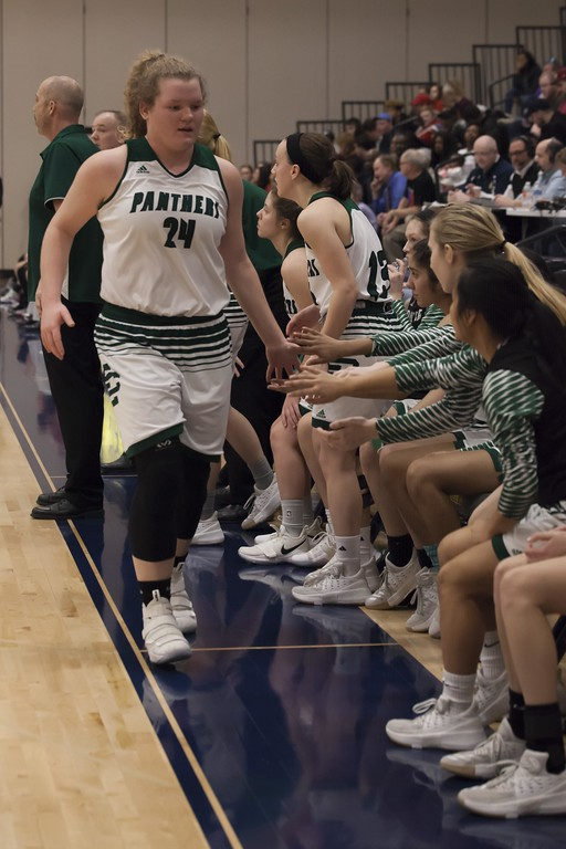 . Jen Forbus - The Morning Journal<br> Coming out of the game, Elyria Catholic\'s Abby Winnen collects support and congrats from her teammates during the Division III North Ridgeville District final against Lutheran West on March 3.